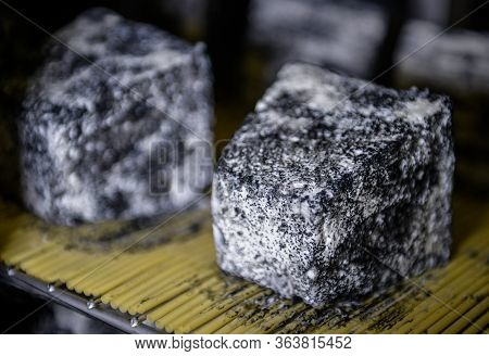 Well Ripened Goat And Ewe Cheeses In Cellar Ripening  With Grey And White Mould