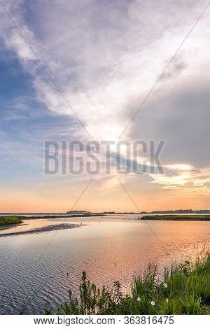 Great Blue Heron Fishing On A Sandbar During A Beautiful Chesapeake Bay Sunset At Blackwater Wildlif