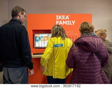 Paris, France - Dec 9, 2017: Rear View Of People In Front Of The Digital Kiosk At Ikea Store Generat