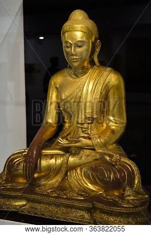 Gilded Statue Of A Buddha In The National Museum Of India In New Delhi