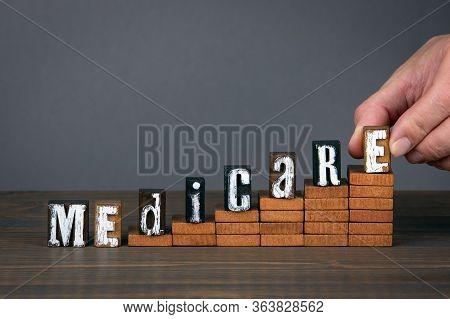 Medicare. Alphabet Letters On Steps. Gray Background