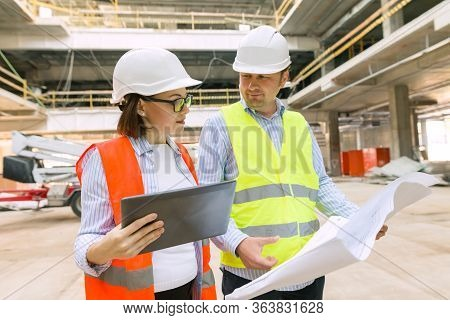 Two Business Builder People At Construction Site. Builder, Inspector, Engineer, Architect, Customer,