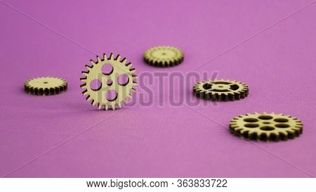 Wooden Details Mechanism. Lying On A Pink Background