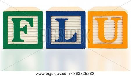 Flu spelled  in bold color aphabet blocks over white in English
