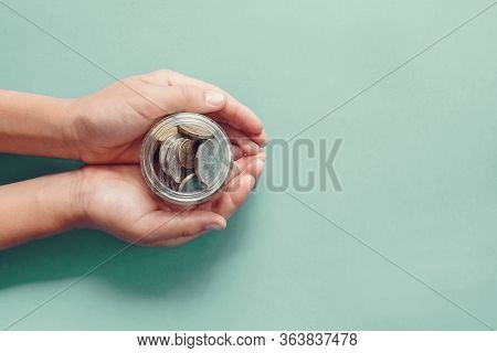 Hands Holding Money Jar, Donation, Saving, Charity, Family Finance Plan Concept, Coronavirus Economi