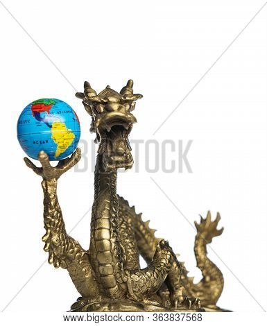 Chinese Dragon Holding A Globe, Turned To The Americas.  Isolated On White