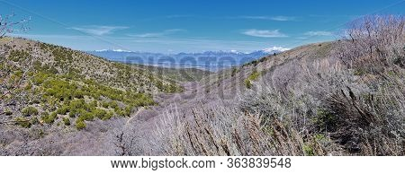 Views Of Wasatch Front Rocky Mountains From The Oquirrh Mountains In Early Spring, Hiking In Yellow