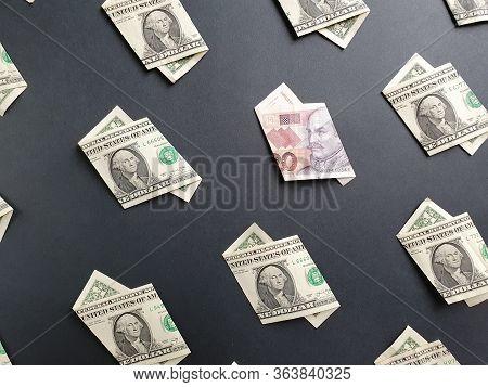 American One Dollar Bills And Croatian Banknote Of Twenty Kuna On The Black Background