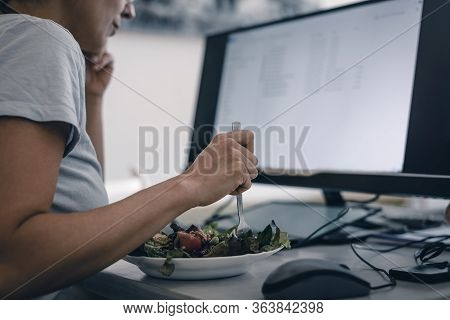 Woman Eating Salad While Work From Home. Busy People Lifestyle. Woman Typing On Laptop Computer. Wor