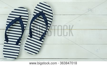 Table Top View Of Accessory For Travel On Summer Holiday Background Concept.flat Lay Of Blue Slipper