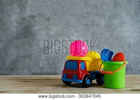Objects On Table Of Decoration Kid Toys For Play Sand In Summer Holiday Background Concept.truck And