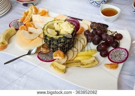 Variety Fruits In Buffet Breakfast Line In Dining Room For Travelers And Guest Select And Eat Drinks