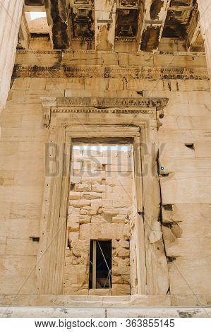 Ancient Greek Ruins Of Propylaea On A Top Of Acropolis Hill In Athens. Acropolis - Main Tourist Attr