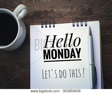 Inspirational Quote - Hello Monday. Lets Do This. Handwriting Text Written On A White Notebook With