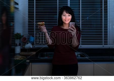 Asian Woman Virtual Happy Hour Meeting And Eating Delivery Pizza From The Box Online With Friend Or