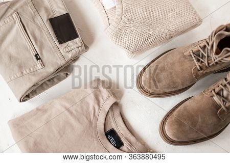 Modern Fashionable Mens Autumn-spring Beige Suede Boots With A Stylish Knitted Sweater On A White Ta