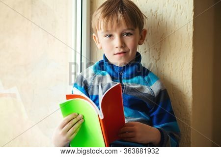 Schoolboy With Books Near Window. Back To School.