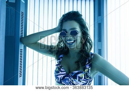 Pretty Cheerful Young Hipster Woman In Sunglasses In A Stylish Swimsuit With Positive Cute Smile Enj