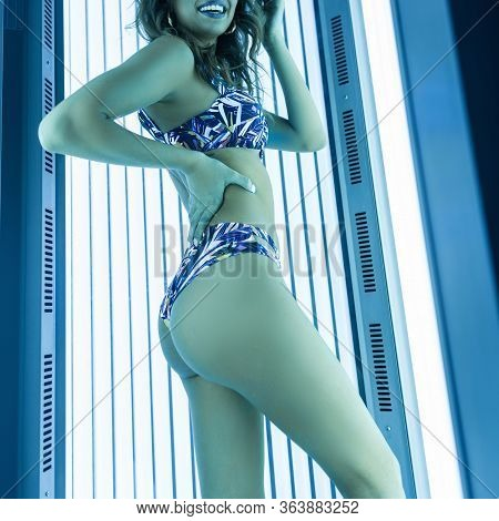 Happy Young Woman With A Cute Smile In A Fashionable Blue Swimsuit With A Beautiful Figure And Gorge