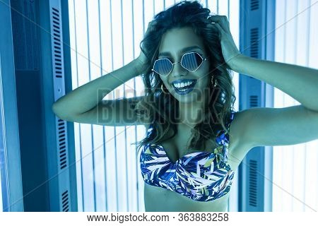 Luxury Happy Sexy Young Woman In A Stylish Swimsuit In Trendy Sunglasses Sunbathes And Smiling In A