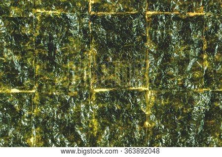 Crispy Nori Seaweed Background With Copy Space. Japanese Or Korean Roasted Food Nori Texture. Dry Se