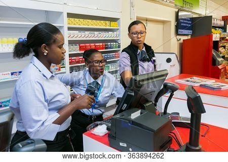 Soweto, South Africa - December 1, 2016: African Cashiers At Checkout At Local Pick N Pay Grocery St