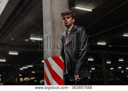 American Trendy Young Man Model In A Youth Oversized Fashionable Black Leather Jacket With A Stylish