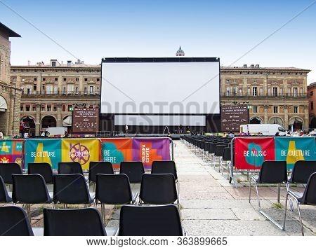 Bologna / Italy - July 18, 2019: Outdoor Cinema, White Projection Screen. Piazza Maggiore, Bologna.