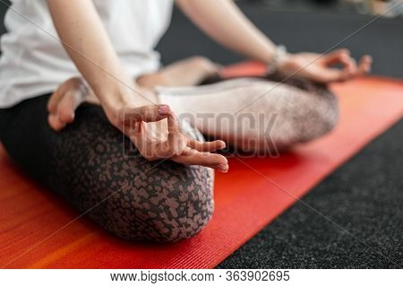 Closeup Of A Young Woman In Meditation In The Gym. Yoga And Healthy Lifestyle Concept. Relax Time.