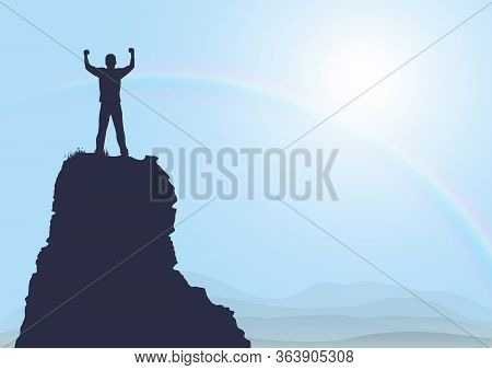 Silhouette Of Man Standing On Top Of The Mountain With Fists Raised Up On Sunrise With Rainbow Backg