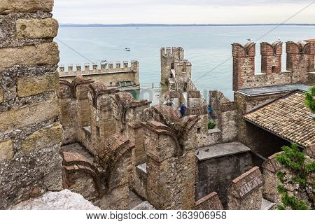 Sirmione, Italy - October 01, 2015 : View Of The Lake Garda Located Behind The Walls Of The Castello