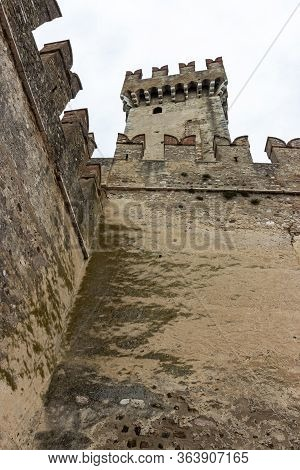 Sirmione, Italy - October 01, 2015 : View Of The Corner Tower Of The Castello Scaligero Fortress Fro