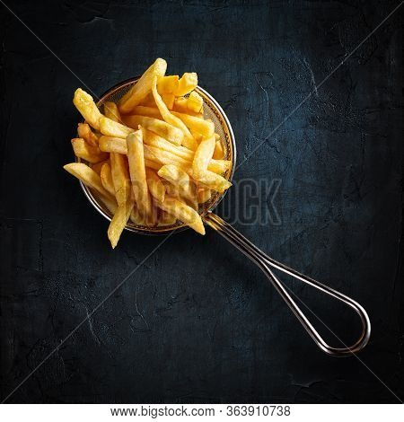French Fries In Fancy Metal Basket On Black Background. Top View.