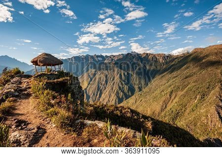 Shelter In Sunrise At The Top Of The Machu Picchu Mountain (3,061 M). View Of The Ancient City Of Ma