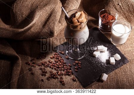 Iced Korean Dalgona Coffee, A Trendy Fluffy Creamy Whipped Coffee With White Tube And Ice. Trendy Co
