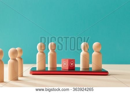 Online Shopping Via Smartphone App. On-line Supermarket. E-store And E-commerce. Wooden Figures On C