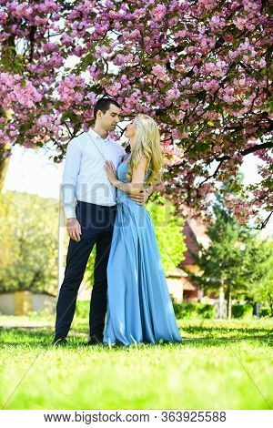 Passion Concept. Man And Woman In Blooming Garden. Couple Spend Time In Spring Tree Garden. Couple I