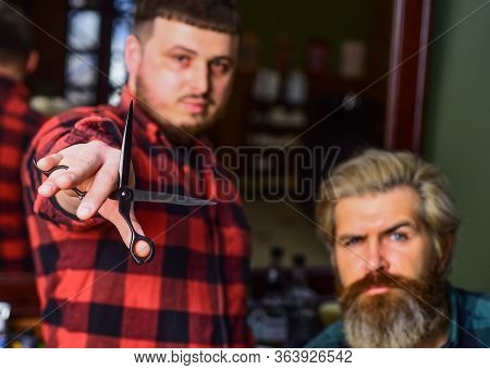 Barber Works On Hairstyle For Bearded Man Barbershop Background. Barber And Hair Stylist Dedicate To