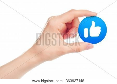 Kiev, Ukraine - May 15, 2019: Hand Holds New Facebook Like Icon Printed On Paper. Facebook Is A Well