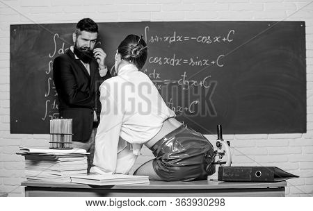 Smart And Sexy. Sexy Teacher Seduce Student To Study. Sexy Woman Sit On School Desk. Sensual Girl In