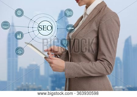Seo Directions With Icons Of Keyword Research, Customization And Others. Woman Using Tablet