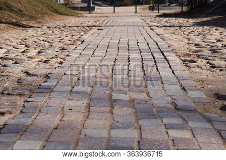 The Sidewalk Paved With Brick Blocks Goes With The Prospect Of A Distance. Comfortable Straight The