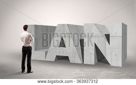 Rear view of a businessman standing in front of LAN abbreviation, modern technology concept