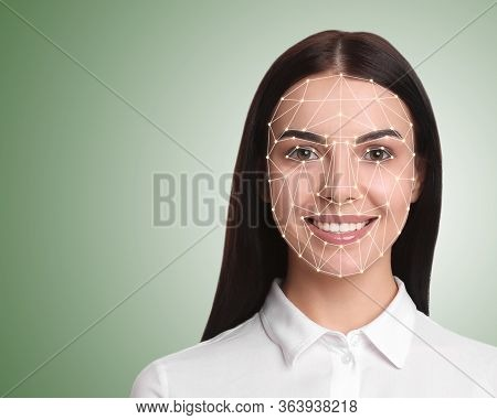 Facial Recognition System. Young Woman With Biometric Identification Scanning Grid On Light Green Ba