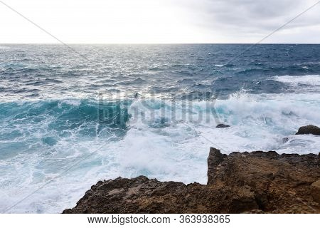 Waves Hitting The Rocky Cliffs In A Beach Located In Cyprus, This Weather Might Be Dangerous For Wat