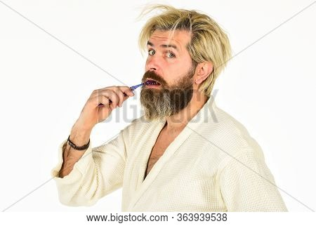 Stay Healthy. Keep Teeth Healthy. Brush Teeth. Morning Routine. Oral Hygiene. Mature Man In Bathrobe