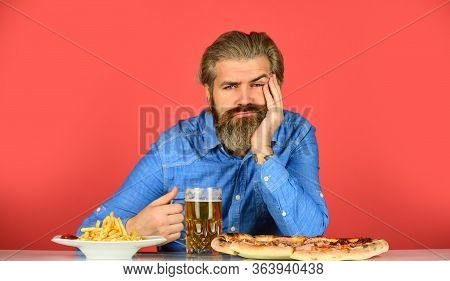 Bored And Sad. Beer And Food. Dinner At Pub. Hungry Man Going To Eat Pizza French Fries And Drink Be