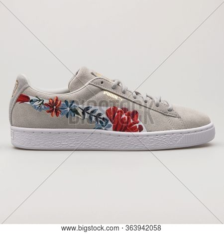 Vienna, Austria - February 19, 2018: Puma Suede Hyper Embellished Grey And White Sneaker On White Ba