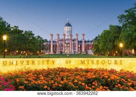 COLUMBIA, MISSOURI - AUGUST 27, 2018: The University of Missouri campus and main sign at Francis Quadrangle during twilight.