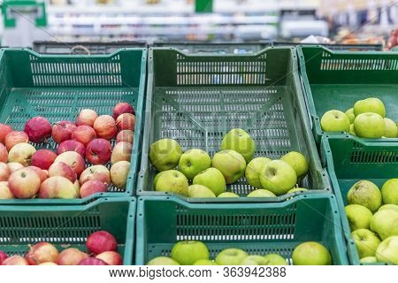 Baskets Filled With Green And Red Apples At A Supermarket With A Visible Scarcity In Supply. Nutriti